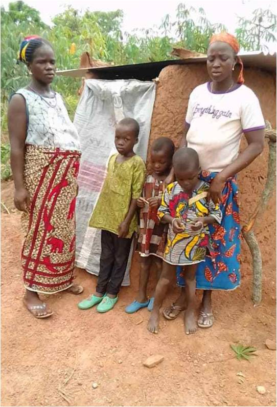 Family shows off newly constructed pit latrine