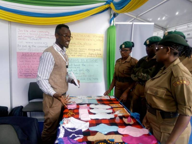 Daniel Karanja explains Menstrual Health and Hygiene to a team of police officers at a conference in Kenya