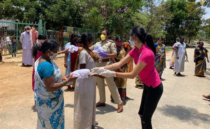 Distributing sanitary pads to vulnerable women in India